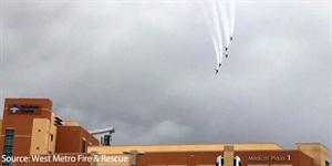 Thunder birds fly over a hospital.