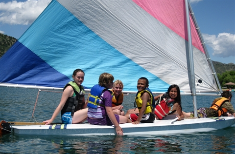 Youth sail on a boat during Camp Eco.