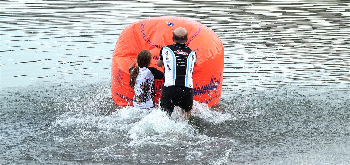 A child and adult push out on the lake during the event.