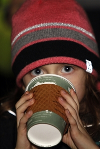 Child drinking cocoa at Lakewood Lights