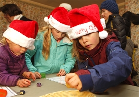 Kids playing dreidle at Lakewood Lights