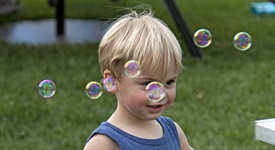 Child with bubbles at Rockin' Block Party