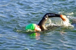 A swimmer trains during open swim in Bear Creek Lake.