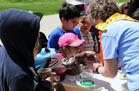 A group of children create their own seedlings during Heritage Days.