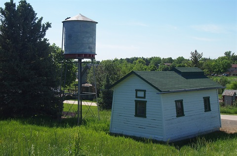 A back view of the pump house and water tower historic structure.