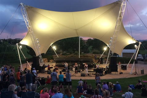 A concert takes place at the outside amphitheatre at Lakewood Heritage Center.