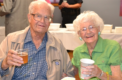Two participants raise glasses during a lunch at Clements Center.
