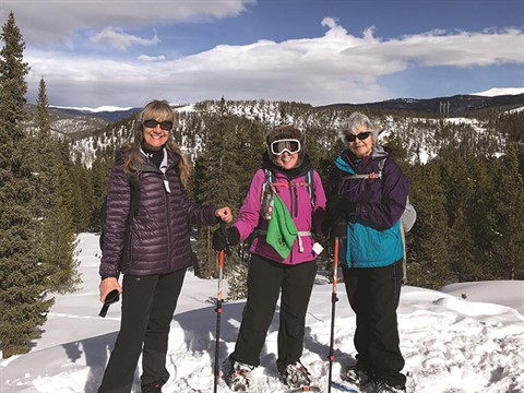 Three skiers during a day trip