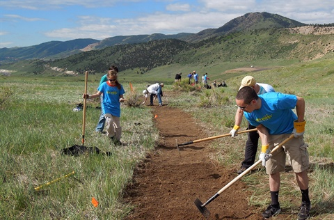 National Trails Day volunteers landscape a trail in Bear Creek Lake Park.