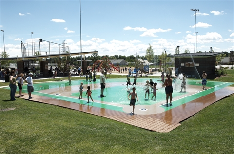 Ray Ross Park Splash Pad, picnic shelter and playground in the background