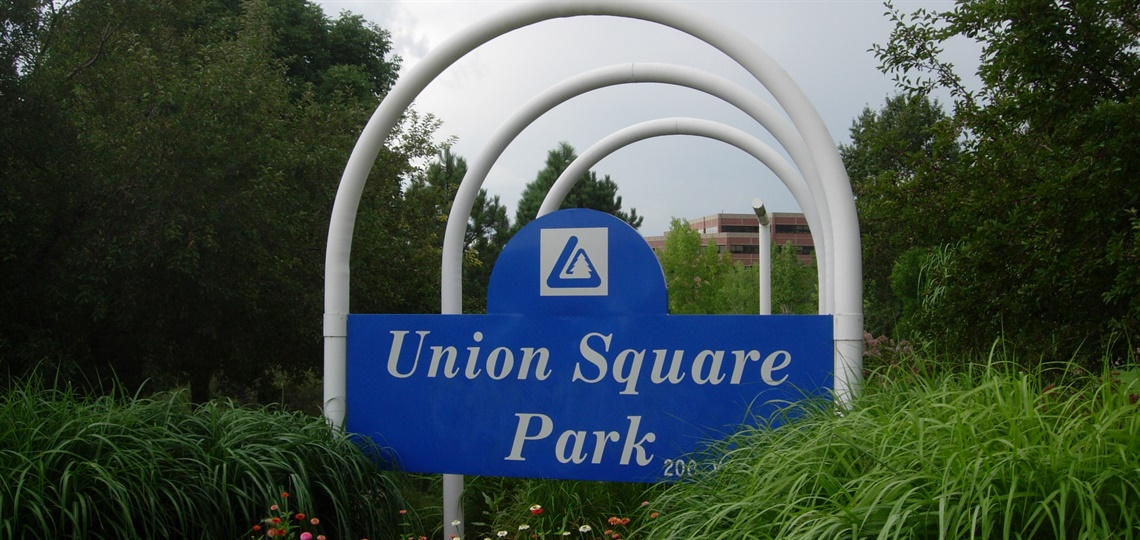 Union Square Park sign and flowers