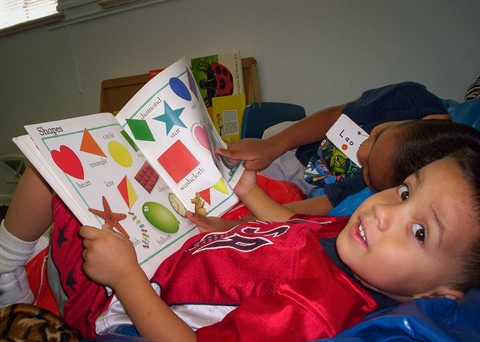 A child reads during Head Start.
