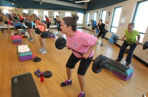 A strength training class takes place in Carmody Rec Center.