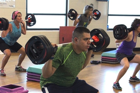 A strength training BodyPump class takes place.