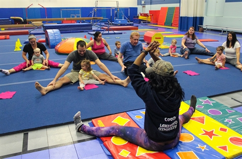 A gymnastics class takes place in the Link gymnasium.