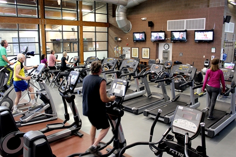 Visitors work out in the cardio equipment area of Whitlock Rec Center.
