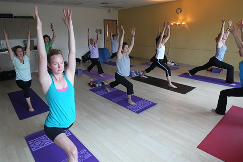 A yoga class takes place in the Carmody Rec Center.