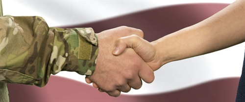 Vet in uniform shakes hands