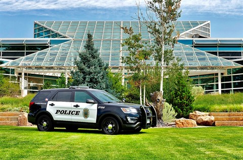 Lakewood patrol car on the grass in front of the police department.