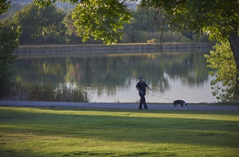 A man walking a dog in kendrick-park