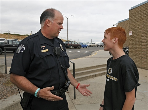 School Resource Officer talking with a student.
