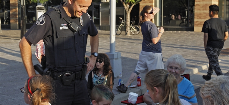 A Police officer speaking to citizens.